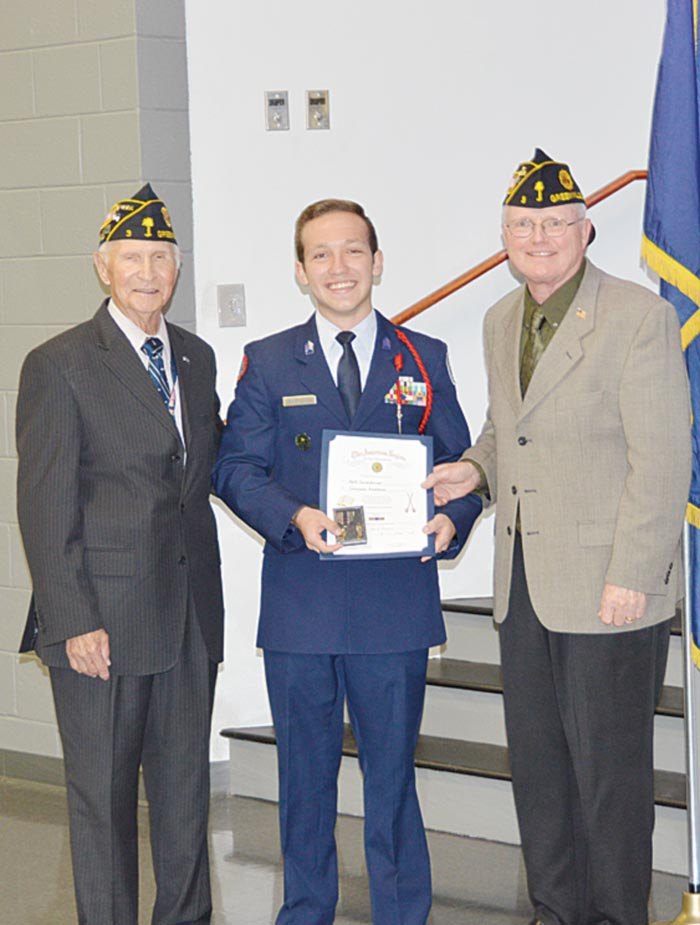 Cadet Capt. Keith Lewandowski is presented the American Legion Scholastic Excellence Certificate and Medal by WWII Veteran Homer Bryant and Lt. Col. David Rogers, USAF (Ret).