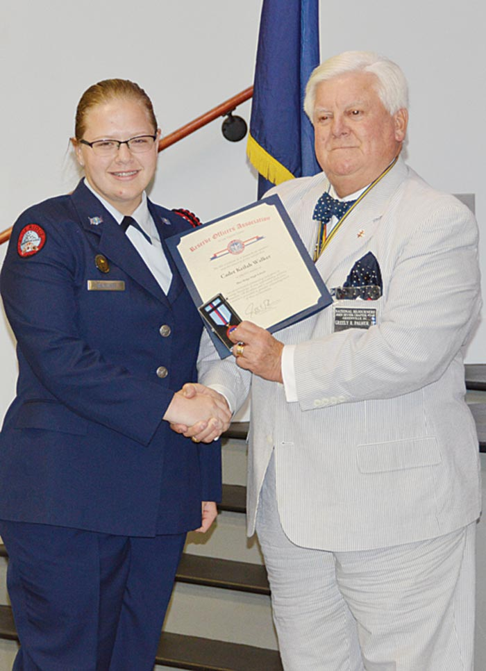 Cadet Keilah Walker is presented the Reserve Officers Association of the United States Certificate and Medal by Maj. Guy Palmer, US Army (Ret).