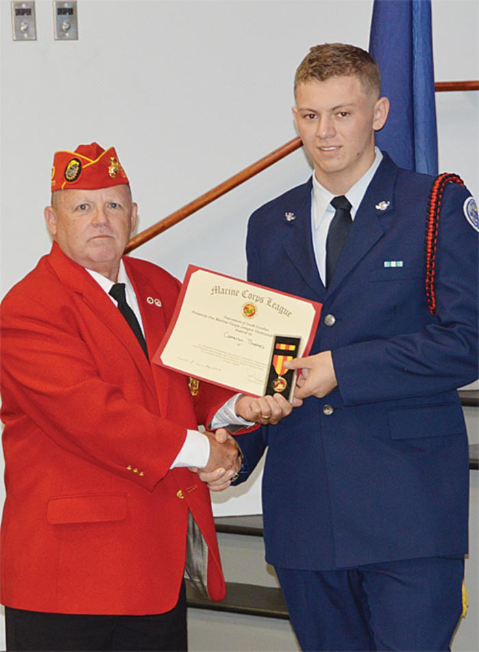 Cadet Cameron Thames is presented the U.S. Marine Corps League Department of South Carolina Outstanding Award Certificate and Medal by Wade Rhoney.