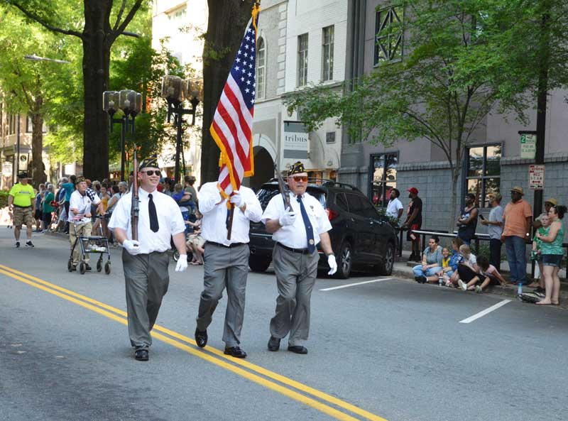 Color Guard Members Dale McCoy, Jamie Richards, Bruce Bartlett of American Legion Major Rudolf Anderson, Jr. Post 214 take part in 2019 Armed Forces Day Parade Downtown Greenville, S.C. Charlie Porter follows in background.
