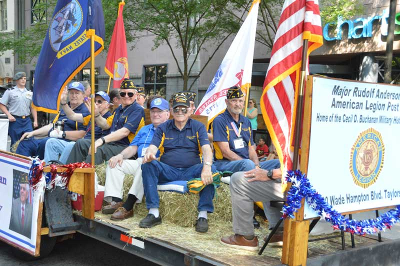 Veterans and members of American Legion Major Rudolf Anderson, Jr. Post 214 enjoy their part  of riding on a float in the 2019 Armed Forces Day Parade Downtown Greenville, S.C.