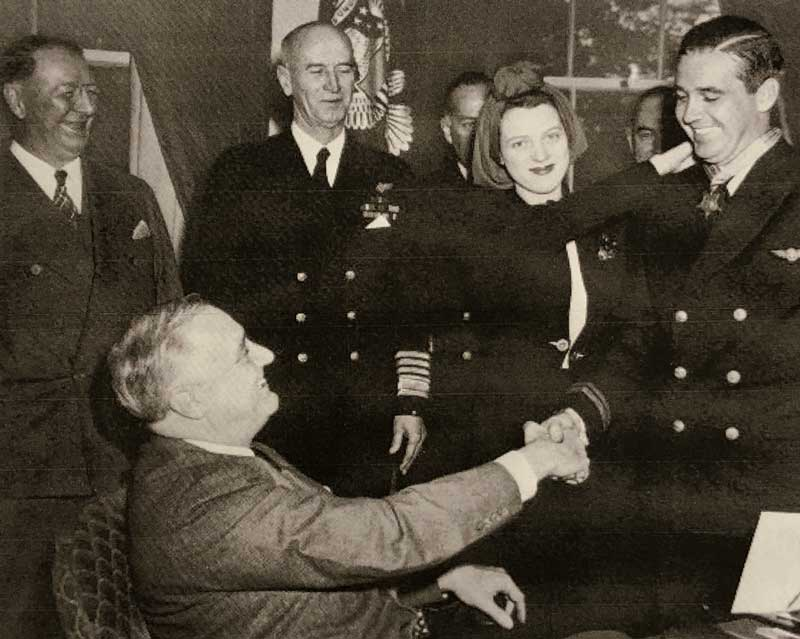 President Franklin Roosevelt awards the Congressional Medal of Honor, April 21, 1942, to Lt. Lohmander Boward O'Hare, Jr. Ruth O'Hare is beside her husband. - Photo credit: National Archives/Public Domain
