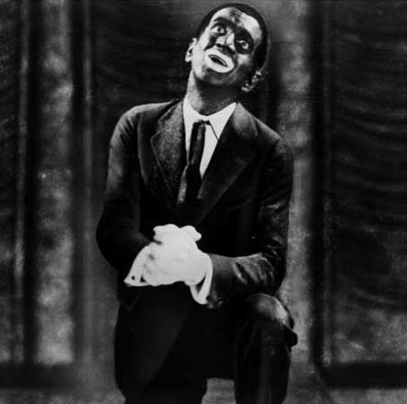 "Al Jolson frequently used blackface as in this 1927 Jazz Singer photo. He introduced many black musical themes and styles to the American public as well as many black musicians. Two of his most famous songs are ""Mammy"" and ""Swanee."""