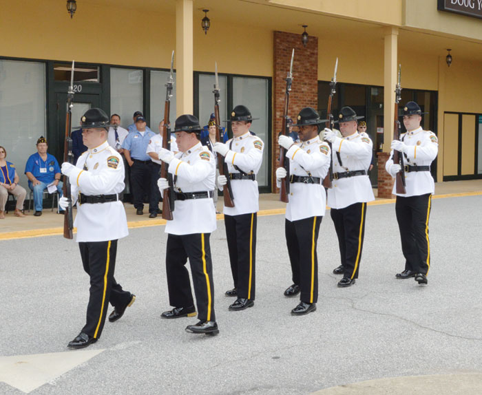 A solemn memorial service is conducted by volunteer members of the Spartanburg County Sheriff Dept. Honor Guard. The service begins with six Honor Guard members carrying M-1 Garand Rifles with fixed bayonets.