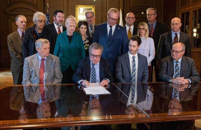 Acting EPA Administrator Andrew Wheeler signs alongside members of the State Review of Oil and Natural Gas Environmental Regulations.