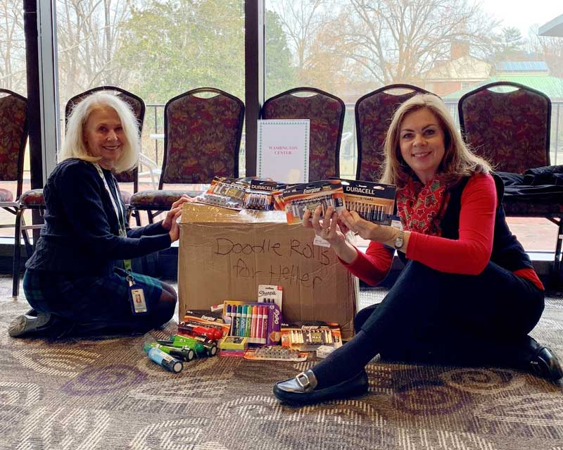 Washington Center staff members, Linda Thigpen (left) and Julie Dail (right) accept gifts for the school thanks to the generosity of Furman University's Heller Service Corps.
