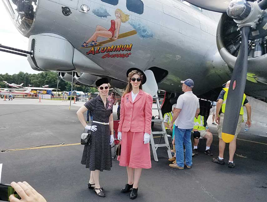 Heather & Raquelle Sheen pose in 1940s garb by the B-17.