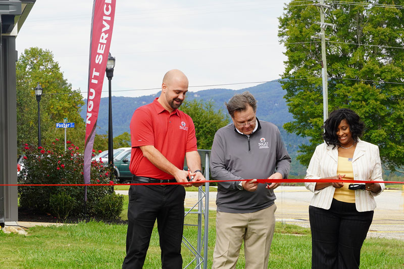 IT Center Dedication_print: North Greenville University President Dr. Gene C. Fant, Jr. (center) and members of the NGU Board of Trustees cut the ceremonial ribbon to signify the opening of the new IT Center at a dedication ceremony on Friday, October 16.