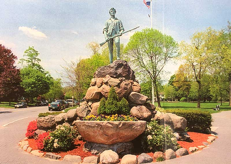 1900 Statue of The Minuteman, Historic Battle Green, Lexington, Massachusetts. A stylized depiction of Capt. John Parker of the Lexington Militia.