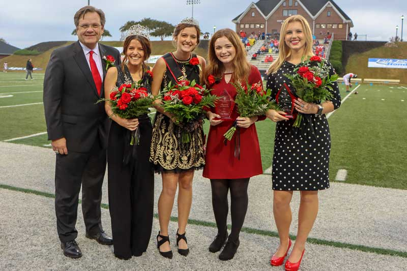 From left: NGU President Dr. Gene C. Fant, Jr.; 2018 Homecoming Queen Allison Yeater; 2019 Homecoming Queen Abbey Blackwood; Abi Waters, second runner-up; and Josey Dorn, first runner-up announced at halftime of the Crusader's homecoming game against Valdosta State.