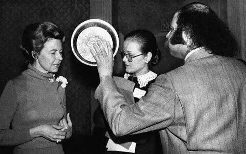 Aron Kay, prepares to hit Phyllis Schlafly, spoken opponent of the Equal Rights Amendment with an apple pie at the Waldorf-Astoria Hotel in New York on Saturday, April 16, 1977 (AP Photo)
