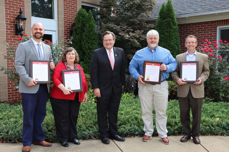 The University honored expiring term Board members. From left: Dr. Travis Agnew from Greenville, Rebecca Coleman from Dillon, NGU President Dr. Gene C. Fant Jr., Rev. Seth Buckley from Moore, and Claude Tackett from Hanahan. Not pictured is James M. Cudd from Gaffney.