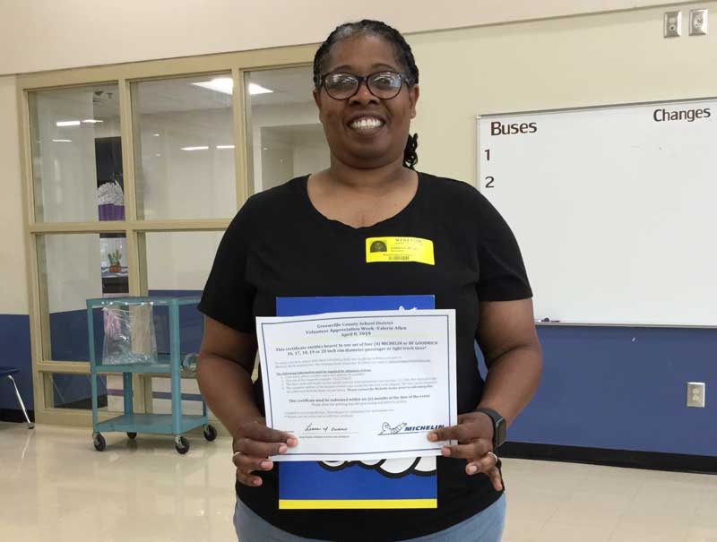 Washington Center parent Valerie Allen receives the Michelin Award as the Greenville County Schools Spotlight Volunteer.